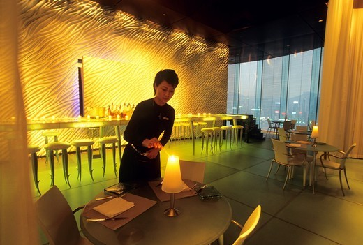 restaurant-bar designed by Philippe Starck, The Peninsula hotel in Tsim Sha Tsui area, Kowloon Peninsula, Hong-Kong, People´s Republic of China, Asia : Stock Photo