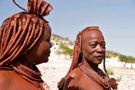 Himba women in a village near Epupa Falls, Namibia, Africa : Stock Photo