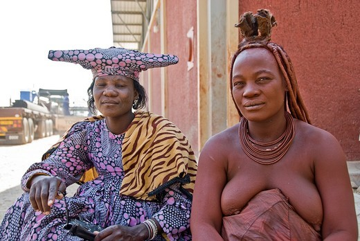 Stock Photo: 1566-755232 Himba and Hererowomen in a village near Epupa Falls, Namibia, Africa