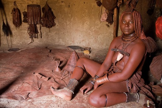 Himba woman in her hut in a village near Epupa Falls, Namibia, Africa : Stock Photo