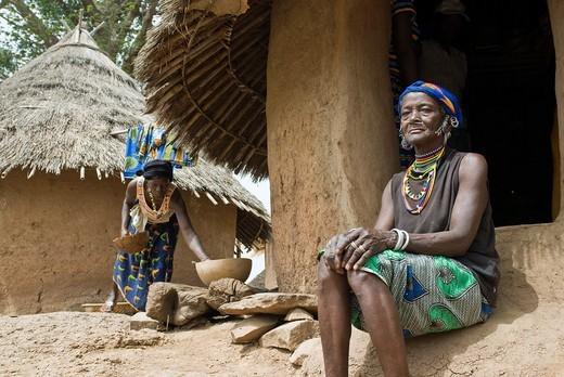 African bedik women sitting on the threshold of her hut, Iwol village, Bassari country, Senegal, Africa : Stock Photo