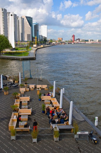 Restaurant bar terrace at Leuvehaven by Nieuwe Maas waterway Rotterdam the province of South Holland the Netherlands Europe : Stock Photo