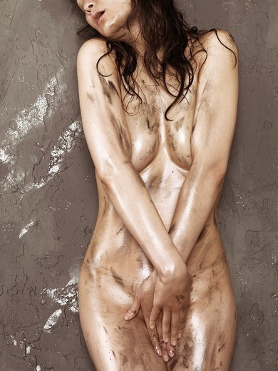 Stock Photo: 1566-757234 Beautiful naked woman with shiny soiled body