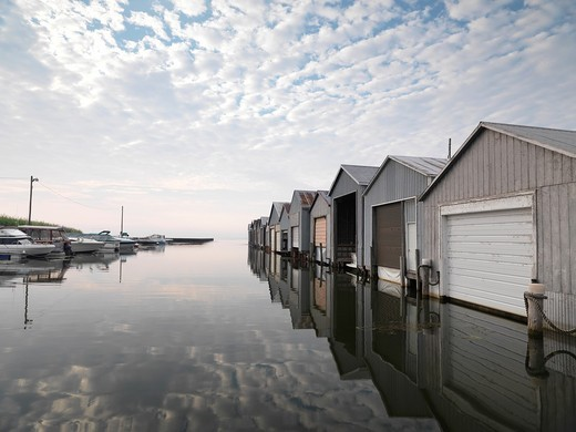 Boat houses at Lake Erie Long Point Beach at dawn, Ontario, Canada : Stock Photo