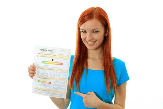Young woman with an Energy Performance Certificate : Stock Photo