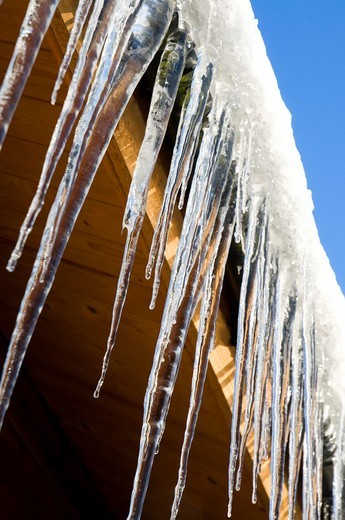 Stock Photo: 1566-760753 icicles hanging from a shed in winter