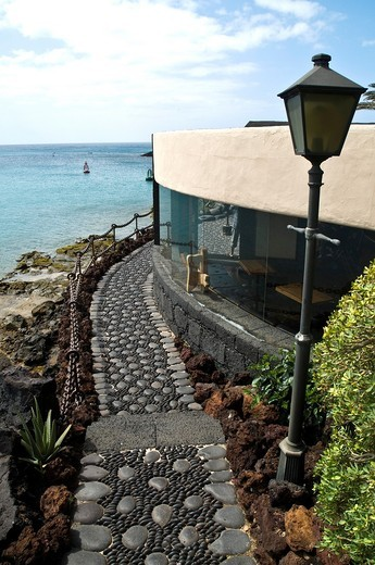 Stock Photo: 1566-761276 Castle San Jose ARRECIFE LANZAROTE Cafe restaurant path and harbour view