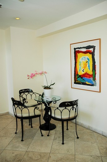 A painting of a sheep by Menashe Kadishman hangs on a wall in a home : Stock Photo