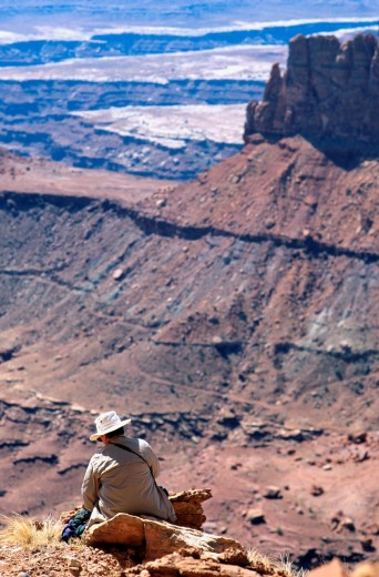 Stock Photo: 1566-762703 Model Released Woman Hiker Sitting on a Rock, Canyonlands National Park, Utah, USA