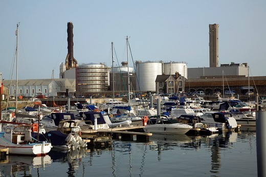 Stock Photo: 1566-762966 Oil storage tanks and power station chimneys, St Sampson harbour, Guernsey