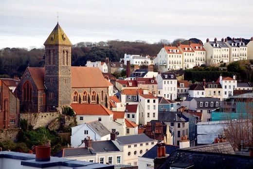 Buildings on hillsides, St Peter Port, Guernsey, Channel Islands, UK : Stock Photo
