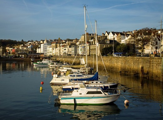Boats in the harbour and the town of St Peter Port, Guernsey, Channel Islands, UK : Stock Photo