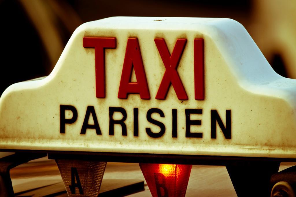 Stock Photo: 1566-763762 Taxi sign  Paris, France