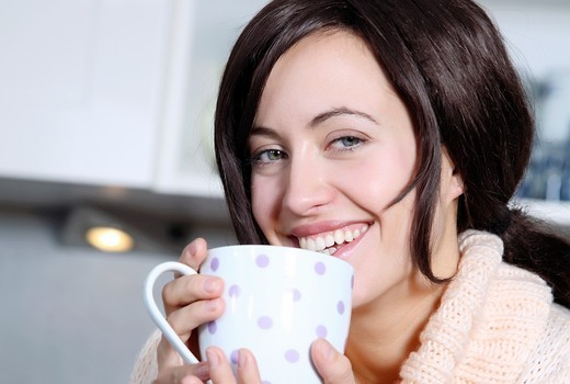 woman drinking a cup coffee : Stock Photo