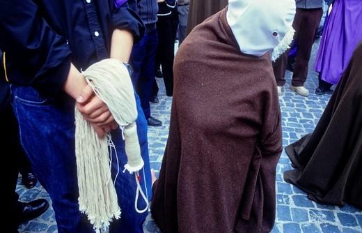 Stock Photo: 1566-766232 'Picao' penitent and skein for flagellate 'Los Picaos', Holy Week procession  Cofradia de la Santa Vera Cruz de los disciplinantes  San Vicente de la Sonsierra, La Rioja, Spain