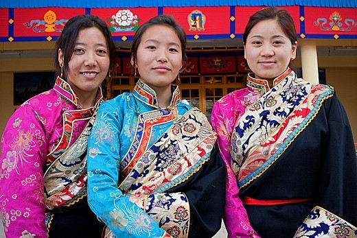 Tibetan women wearing typical dress , in Namgyal Monastery,in Tsuglagkhang complex  McLeod Ganj, Dharamsala, Himachal Pradesh state, India, Asia : Stock Photo
