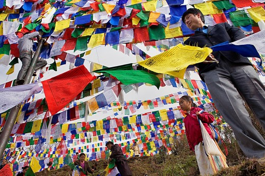 People hanging Tibetan prayer flags in Lhagyal Ri, near Tsuglagkhang complex,McLeod Ganj, Dharamsala, Himachal Pradesh state, India, Asia : Stock Photo