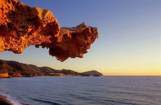 Gargoyle Rocks eroded by wind, sea water and sand in Playa del Arco Los Escullos  Cabo de Gata-Nijar Natural Park  Biosphere Reserve, Almeria province, Andalucia, Spain : Stock Photo