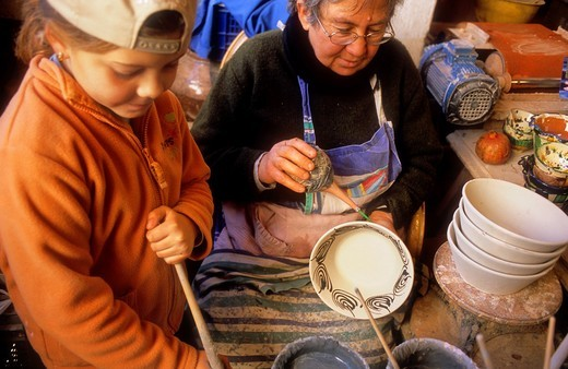 Old woman and her granddaughter painting ceramic typical workshop of pottery  Nijar, Almeria province, Andalucia, Spain : Stock Photo