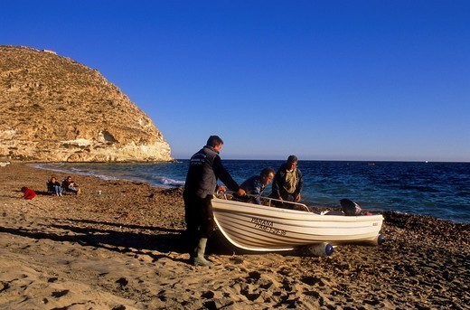 Stock Photo: 1566-766560 Agua amarga beach  fishermen and tourists  Cabo de Gata-Nijar Natural Park  Biosphere Reserve, Almeria province, Andalucia, Spain
