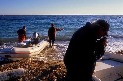 Agua amarga beach  Fishermen  Cabo de Gata-Nijar Natural Park  Biosphere Reserve, Almeria province, Andalucia, Spain : Stock Photo