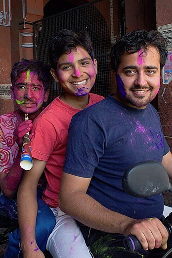 Friends celebrating the Holi spring festival to celebrate the love between Krishna and Radha,Jaipur, Rajasthan, India : Stock Photo