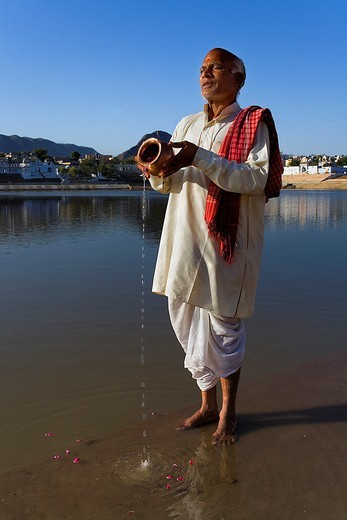 Sadhu praying at the holy lake,pushkar, Rajasthan, india : Stock Photo