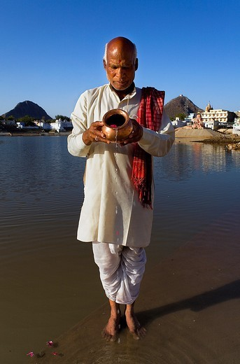 Sadhu praying at the holy lake,pushkar, Rajasthan, india : Stock Photo