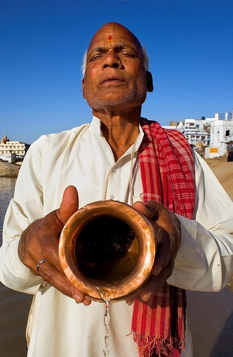 Stock Photo: 1566-767033 Sadhu praying at the holy lake,pushkar, Rajasthan, india