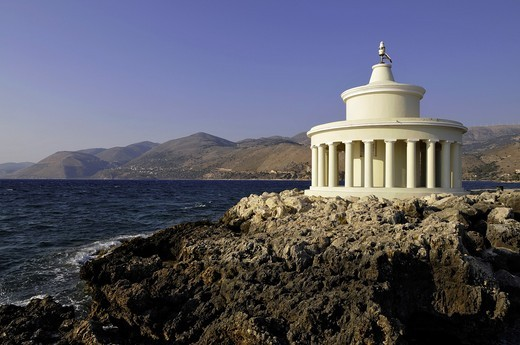 Stock Photo: 1566-767654 The Agios Theodoros lighthouse at the entrance to Argostoli bay  The original lighthouse was built by Charles Napier, in the 1820s and rebuilt to the same design after an earthquake in 1875