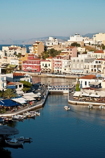 Looking down on the inner lake and outer harbour at Agios Nikolaos in Eastern Crete, Greece : Stock Photo