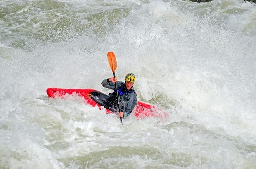 Kayaking the Drop which is rated Class 5 on the Milner Mile section of the Snake River near the town of Murtaugh in southern Idaho : Stock Photo