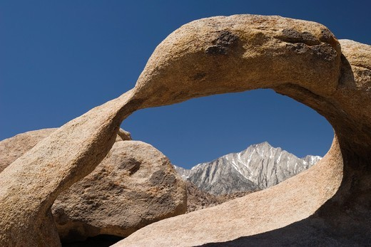 Stock Photo: 1566-768233 Natural arch at the Alabama Hills frames Lone Pine Peak in the Eastern Sierra Nevada Mountains, California