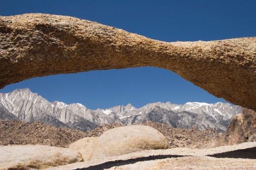 An arch frames Lone Pine Peak, Alabama Hills near Lone Pine, California : Stock Photo
