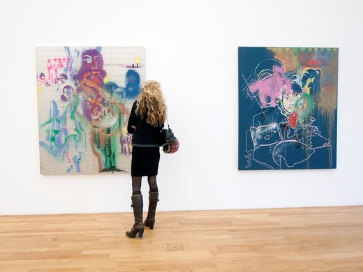 Woman looking at modern art paintings at Bonn Kunstmuseum or Art Museum in Germany : Stock Photo