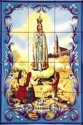 Portuguese glazed tiles azulejo depicting Our Lady of Fatima : Stock Photo