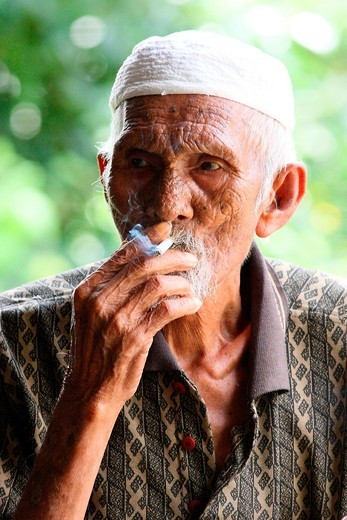 Portrait of old man smoking, malaysia. : Stock Photo