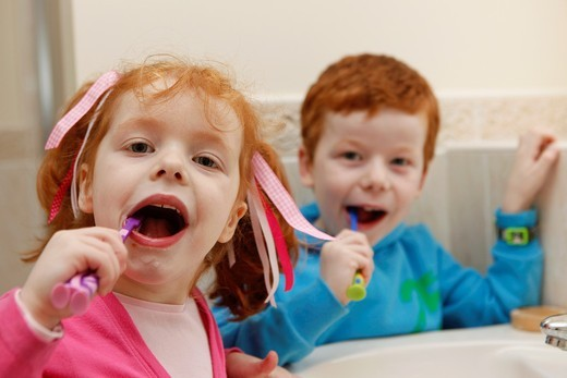 Little boy and girl at home, brushing teeth in bathroom : Stock Photo