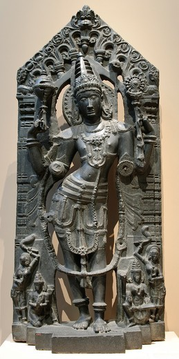 Vishnu with his Mount, Garuda, his Consort, Lakshmi, and Attendants, 12th–13th century, Kakatiya period, India, Andhra Pradesh, Kalyani region, Black stone H , without dowel, 6´ 182 9 cm, W  32 1/2 in , 82 6 cm, D  13 in , 33 cm, H  with dowel, 6´ 4 1/2 i. Vishnu with his Mount, Garuda, his Consort, Lakshmi, and Attendants, 12th–13th century, Kakatiya period, India, Andhra Pradesh, Kalyani region, Black stone H , without dowel, 6´ 182 9 cm, W  32 1/2 in , 82 6 cm, D  13 in , 33 cm, H  with dowel : Stock Photo