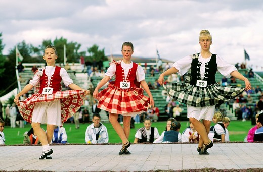 Stock Photo: 1566-774256 Traditional Scottish Highland dancing contest at the Braemar Gathering highland games in Grampian region of Scotland UK