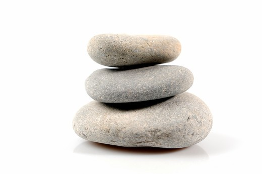Three boulders piled on white background photographed slightly back- : Stock Photo