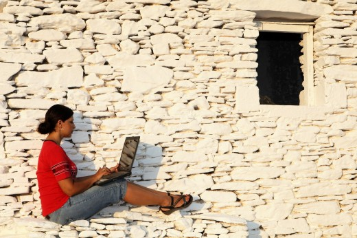 Stock Photo: 1566-779790 Model with lap top in Kythnos island Greece