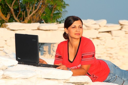 Girl with laptop : Stock Photo