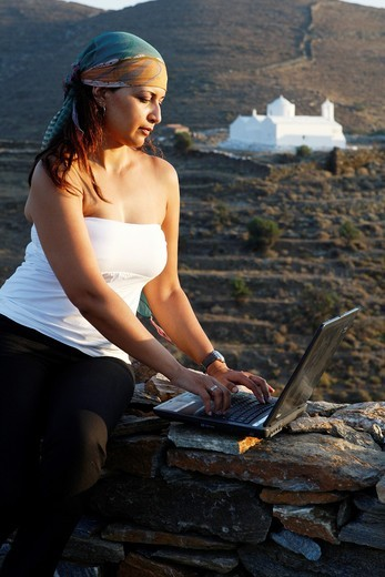 Stock Photo: 1566-779796 Model with lap top in Kythnos island Greece