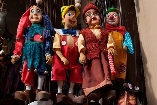 Stock Photo: 1566-781996 Souvenir,Tipical marionettes hanging from their threads, Prague, Czech Republic