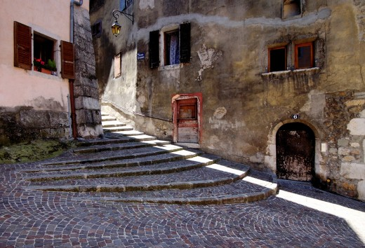 Stock Photo: 1566-784695 Small street in Annecy, romantic town in France called ´A Little Venice´ because of canals and charm, late afternoon
