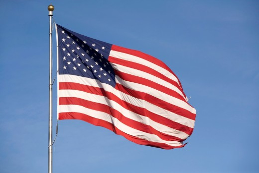 Stock Photo: 1566-785895 A large American flag waves in the wind on a bright and sunny day