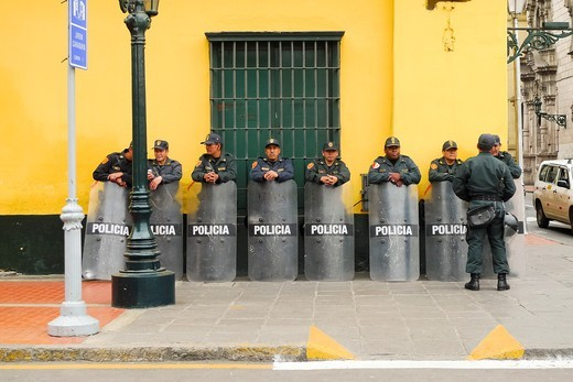 Group of Police lined up against a wall holding shields  Lima, Peru : Stock Photo