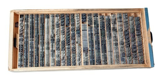 Old letters made of lead for letterpress printing, cursive font in a letter case : Stock Photo