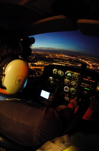 Night VFR flight in a small plane Cessna 172 over Liege town, Belgium, Europe : Stock Photo